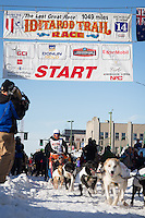 Cindy Abbott and team leave the ceremonial start line at 4th Avenue and D street in downtown Anchorage during the 2014 Iditarod race.<br /> Photo by Jim R. Kohl/IditarodPhotos.com