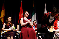 Stage IV finalist Melanie Laurent from France, center, reacts as she realizes that she has won the first prize of the 11th USA International Harp Competition at Indiana University in Bloomington, Indiana on Saturday, July 13, 2019. (Photo by James Brosher)