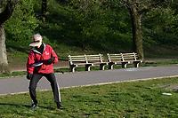 New York, New York City in the time of Coronavirus. Men playing double frisbee in Riberside Park.