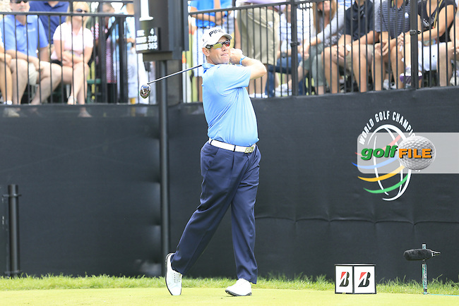 Lee Westwood (ENG) tees off the 1st tee to start his match during Sunday's Final Round of the 2013 Bridgestone Invitational WGC tournament held at the Firestone Country Club, Akron, Ohio. 4th August 2013.<br /> Picture: Eoin Clarke www.golffile.ie