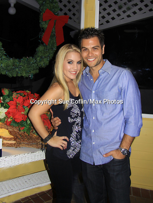General Hospital Kristen Alderson and Erik Valdez check out Christmas for 2012 (Photo by Sue Coflin/Max Photos)