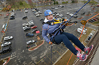 Jene Huffman-Gilreath (from left) of Rogers takes her turn on the ropes Saturday, March 11, 2017, during the Sunshine School & Development Center's rappelling fundraiser with Over The Edge at the 8W Center in Bentonville. The school began a campaign in January, with participants who reached their fundraising goal able to participate in rappelling from the roof of the 6-story building. Over the Edge is a company which specializes in producing events for non profits using equipment and techniques used in commercial rope-access work such as sign installation and window washing. The event had raised more than $57,000 for the school, with more donations still coming in Saturday morning. Located in Rogers, the Sunshine School & Development Center serves children and adults with developmental disabilities, including a preschool.
