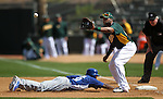 Dodgers' Tony Gwynn Jr. dives back to first under a throw to Oakland A's Brandon Allen in a Cactus League preseason game between the Dodgers and the A's in Scottsdale, Ariz., on Wednesday, March 7, 2012. The game ended 3-3..Photo by Cathleen Allison