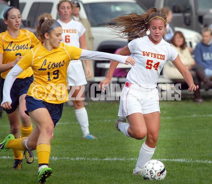 LOWER GWYNEDD, PA -  OCTOBER 23: Lower Moreland's Melinda Martins (19) chases Gwynedd Mercy Academy's Margaret Jones (54) during a District One Class AA playoff game October 23, 2013 in Lower Gwynedd, Pennsylvania. Gwynedd Mercy Academy defeated Lower Moreland 5-1. (Photo by William Thomas Cain/Cain Images)