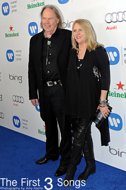 Neil Young and wife Pegi Young attend the Warner Music Group/Bing Grammy Event at the Soho House in LA on Sunday February 13, 2011.