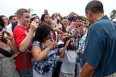 A young girl salutes United States President Barack Obama as he shakes hands along a ropeline with members of the military and their families during the Fourth of July celebration on the South Lawn of the White House, July 4, 2011. .Mandatory Credit: Pete Souza - White House via CNP