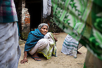 "Saraswati Saha, 84, a refugee of The Partition discusses her situation with other elderly women in Cooper's Camp, Nadia district, Ranaghat, North 24 Parganas, West Bengal, India, on 19th January, 2012. She vividly remembers being brought to the refugee camp first by train and then truck. ""My daughter has died and I'm still here,"" she says over and over again. Over 60 years after the bloody creation of Bangladesh in 1947, refugees who fled what was then known as West Pakistan to India still live as refugees, standing in line for government handouts..Photo by Suzanne Lee for The National (online byline: Photo by Szu for The National)"