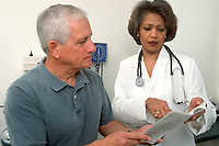 A doctor offers medical advice to a patient during an office visit.