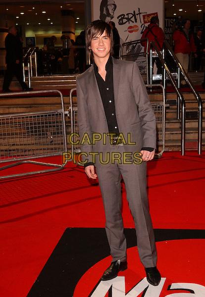 RICHARD FLEESHMAN.The Brit Awards 2006.Earls Court, London England.15 February 2006.Ref: FIN.earl's pop music Brits full length grey gray suit.www.capitalpictures.com.sales@capitalpictures.com.© Capital Pictures.