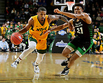 SIOUX FALLS, SD - MARCH 10: Vinnie Shahid #0 of the North Dakota State Bison drives past Ethan Igbanugo #21 of the North Dakota Fighting Hawks during the men's championship game at the 2020 Summit League Basketball Tournament in Sioux Falls, SD. (Photo by Dave Eggen/Inertia)