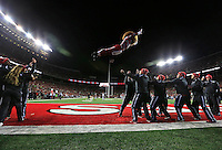 Ohio State cheerleaders launch Brutus Buckeye through the air during the first half of the NCAA football game against the Illinois Fighting Illini at Ohio Stadium on Nov. 1, 2014. (Adam Cairns / The Columbus Dispatch)
