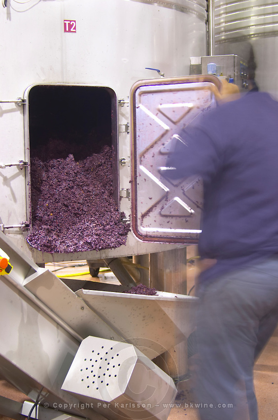 Emptying tank from skins and pips residue after fermentation. Herdade das Servas, Estremoz, Alentejo, Portugal