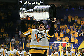 June 11th 2017, Nashville, TN, USA;  Pittsburgh Penguins center Evgeni Malkin (71) skates with the Stanley Cup following Game 6 of the Stanley Cup Final between the Nashville Predators and the Pittsburgh Penguins, held on June 11, 2017, at Bridgestone Arena in Nashville, Tennessee.