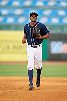 Northwest Arkansas Naturals left fielder Elier Hernandez (21) jogs back to the dugout during a game against the Midland RockHounds on May 27, 2017 at Arvest Ballpark in Springdale, Arkansas.  NW Arkansas defeated Midland 3-2.  (Mike Janes/Four Seam Images)