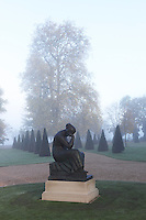 A figure poised in thought forms the focus of one of the circular lawns in the grounds