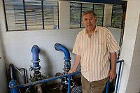 EGYPT, Ismallia , Sarapium forest in the desert, the trees are irrigated by treated sewage water from Ismalia / AEGYPTEN, Ismailia, Sarapium Forstprojekt in der Wueste, die Baeume werden mit geklaertem Abwasser der Stadt Ismalia bewaessert, Pumpenhaus fuer Bewaesserung, Hossam Hammad, Professor der Landwirtschaftlichen Fakultät der Ain Shams University in Kairo