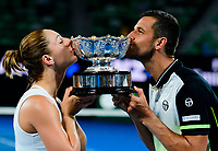 Gabriela Dabrowski of Canada and Mate Pavic of Croatia with the mixed doubles trophy on Day 14 of the Australian Open