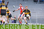 The Gooch sells a dummy to Rathmore's James O'Sullivan during the O'Donoghue Cup final in Fitzgerald Stadium on Sunday