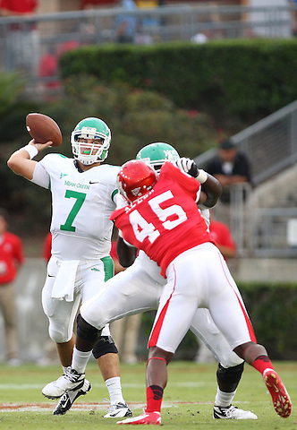 Denton, TX - OCTOBER 6: Quarterback Derek Thompson #7 of the North Texas Mean Green passes the ball as offensive linesman Antonio Johnson #71 blocks defensive lineman Lloyd Allen #45 of the Houston Cougars at Robertson Stadium in Houston on October 6, 2012 in Houston, Texas. Photo by: Rick Yeatts