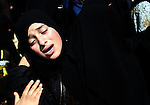 """A relative of Palestinian Hamas militant Abdulrahman al-Zameli mourns during his funeral in Rafah in the southern Gaza Strip July 7, 2014. Israeli air strikes killed six Hamas militants, one of them al-Zameli, in the Gaza Strip on Monday, the Islamist group said, in the deadliest attacks in a surge of violence exacerbated by the kidnapping and killing of three Israeli youths and a Palestinian teen. The Israeli military said its aircraft targeted """"terror sites and concealed rocket launchers"""" in the enclave. It said about 10 rockets hit southern Israel on Monday, wounding one soldier. Photo by Ramadan al-Agha"""