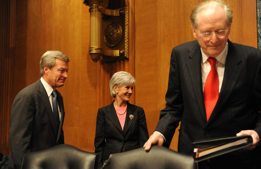 Washington, D.C.- Sen. Max Baucus talks with Kathleen Sebelius, secretary of Health and Human Services, as Sen. John Rockefeller takes his seat before the Senate Finance Committee about President Obama's health care proposals on Feb. 3, 2009. (Amanda Lucidon) .