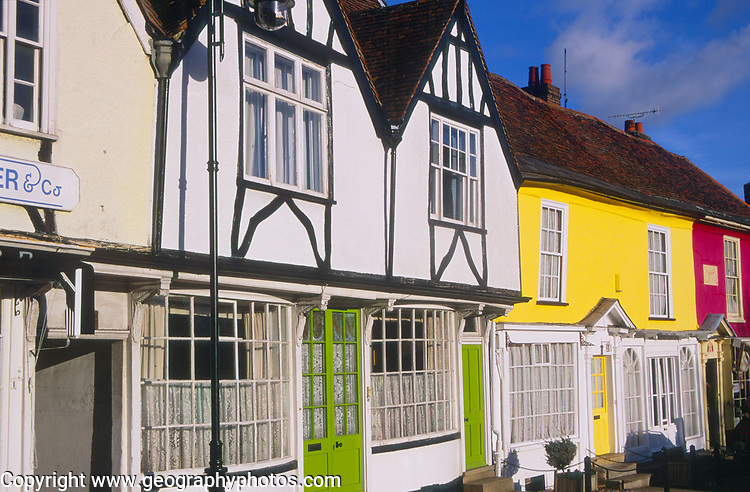 A3AATB Wooden framed colourful Tudor shop fronts Market Hill Woodbridge Suffolk