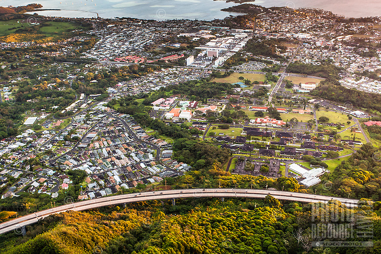 """An aerial view at dawn of Kaneohe and H-3 Freeway from the Haiku Stairs (""""Stairway to Heaven"""") hiking trail in Kaneohe, O'ahu"""