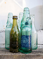BNPS.co.uk (01202 558833)<br /> Pic: PhilYeomans/BNPS<br />  <br /> Water Find...Richard found some old bottles that led to the spring discovery.<br /> <br /> Enviromentalist Richard Stevens is hoping to make a fortune after tapping into a natural spring he has rediscovered on his land.<br /> <br /> Although it sounds more like the hilarious story of the Peckham Spring 'found' by Del Boy in Only Fools & Horses, Richard's inspiration for turning his bottled mineral water into a business has been David Attenborough's Blue Planet.<br /> <br /> The 63-year-old wants to stop people disposing of tens of thousands of plastic bottles of mineral water a year by supplying them with large dispensers they put in their own homes.<br /> <br /> The aim is for customers to use the 11.5 litre tanks to refill and reuse their own bottles with the Yawl Spring mineral water.