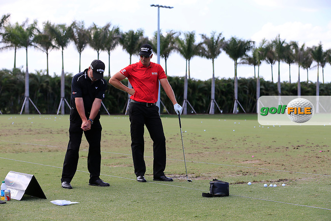Henrik STENSON (SWE) and Pete Cowan on the range during the practice day at the WGC Cadillac Championship, Blue Monster, Trump National Doral, Miami, Florida,USA.<br /> Picture: Fran Caffrey www.golffile.ie
