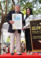 LOS ANGELES, CA. July 31, 2019: Stacy Keach & Rana Ghadban at the Hollywood Walk of Fame Star Ceremony honoring Stacy Keach.<br /> Pictures: Paul Smith/Featureflash