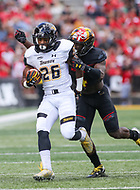 College Park, MD - September 9, 2017: Towson Tigers wide receiver Rodney Dorsey (26) gets tackled by a Maryland Terrapins defender during game between Towson and Maryland at  Capital One Field at Maryland Stadium in College Park, MD.  (Photo by Elliott Brown/Media Images International)