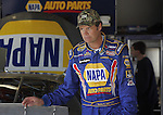 Veteran driver Michael Waltrip walks through the garage area   at Daytona International Speedway in Daytona Beach, Fla., during NASCAR Nextel Cup testing, Wednesday, January 18, 2006.(AP Photo/Brian Myrick)
