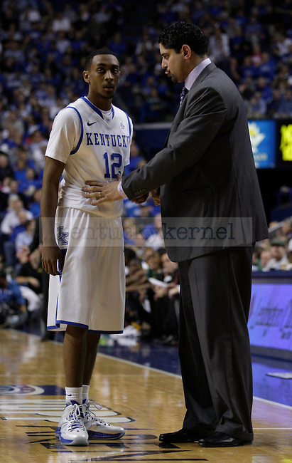 Assistant coach Orlando Antigua talks with sophomore guard Ryan Harrow during the second half of the game between the University of Kentucky and Baylor University, on Saturday, Dec. 1, 2012 at Rupp Arena, in Lexington, Ky. Baylor won 64-55. Photo by Latara Appleby | Staff
