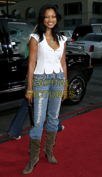 """GARCELLE BEAUVAIS-NILON.The Los Angeles premiere of """"The Dukes Of Hazzard"""".Graumans Chinese Theatre,.Hollywood, 28th July 2005.full length white shirt top denim jeans brown clutch bag boots turquoise nacklace pendant.www.capitalpictures.com.sales@capitalpictures.com.© Capital Pictures."""