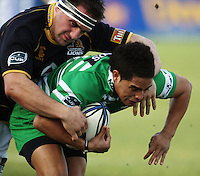 Wellington Adrian Barone tackles Aaron Smith during the Air NZ Cup preseason match between Manawatu Turbos and Wellington Lions at FMG Stadium, Palmerston North, New Zealand on Friday, 17 July 2009. Photo: Dave Lintott / lintottphoto.co.nz