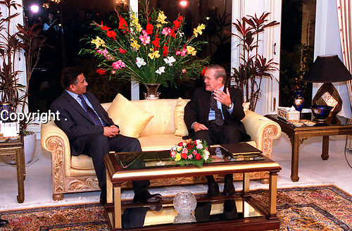 Nov. 4, 2001, Washington, DC, United States<br /> <br /> Secretary of Defense Donald H. Rumsfeld (right) meets with Pakistan President Pervez Musharraf, at the presidential offices in Islamabad, on Nov. 4, 2001.  Rumsfeld and Musharraf are discussing the war against the Taliban and al-Qaeda terrorists in Afghanistan as well as a range of bilateral security issues<br /> <br /> Mandatory Credit: Photo by DoD photo by R. D. Ward. (Released)-