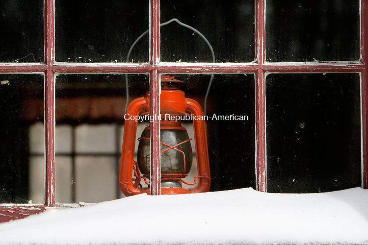 WARREN, CT--18 MARCH 2007--031807JS06-A lantern sits in the window of Warren's 1784 Brick Schoolhouse on Brick School Road.<br /> Jim Shannon / Republican-American