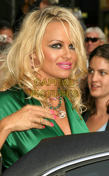 PAMELA ANDERSON.At The David Letterman Show in New York City..August 2, 2004 .headshot, portrait, pink lipstick, wrinkles, heavy eye make-up.www.capitalpictures.com.sales@capitalpictures.com.©Capital Pictures .