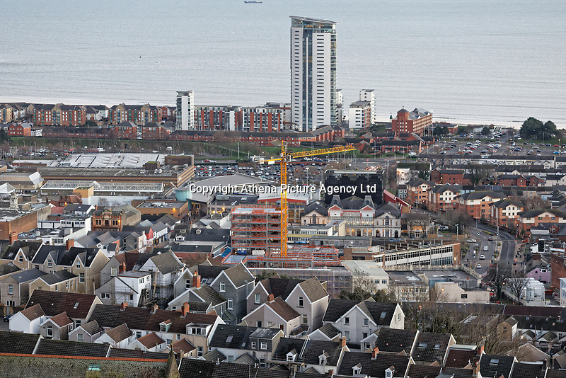 A crane working on a new building on the Kingsway with the marina and Meridian Quay in the background, Swansea, Wales, UK. Wednesday 30 January 2019