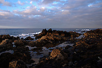 Reflections of clouds in rock pools at dusk, Los Abrigos, Tenerife,Canary Islands.