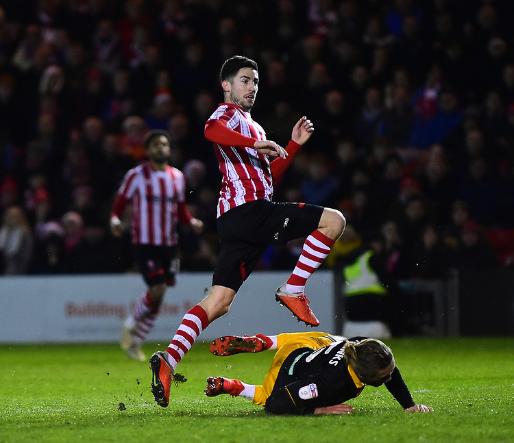 Lincoln City's Tom Pett celebrates scoring his side's third goal<br /> <br /> Photographer Andrew Vaughan/CameraSport<br /> <br /> The EFL Sky Bet League Two - Lincoln City v Newport County - Saturday 22nd December 201 - Sincil Bank - Lincoln<br /> <br /> World Copyright © 2018 CameraSport. All rights reserved. 43 Linden Ave. Countesthorpe. Leicester. England. LE8 5PG - Tel: +44 (0) 116 277 4147 - admin@camerasport.com - www.camerasport.com