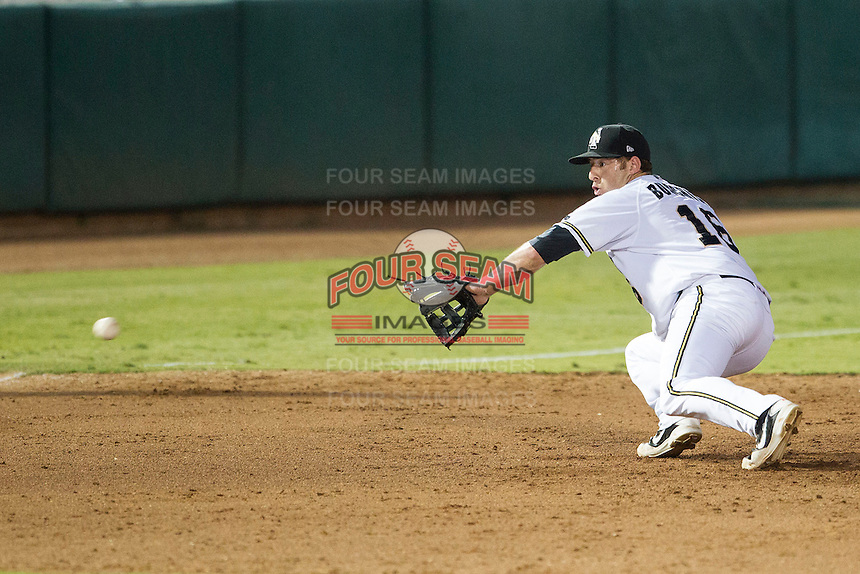 San Antonio Missions third baseman Adam Buschini (16) dives towards a line drive in the Texas League baseball game against the Frisco Roughriders on August 22, 2013 at the Nelson Wolff Stadium in San Antonio, Texas. Frisco defeated San Antonio 2-1. (Andrew Woolley/Four Seam Images)