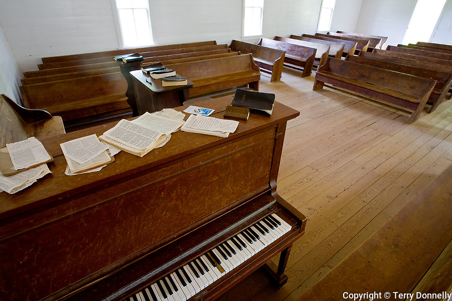 Great Smoky Mts. National Park, TN/NC<br /> Methodist church interior with piano and wood pews in Cades Cove