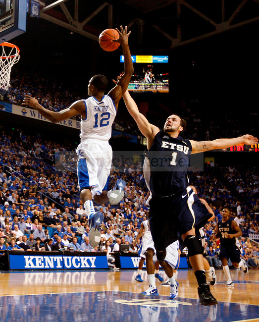 Brandon Knight gets fouled while going up for a dunk in the second half of UK's win over ETSU at Rupp Arena on  Friday Nov. 12 , 2010. Photo by Britney McIntosh | Staff