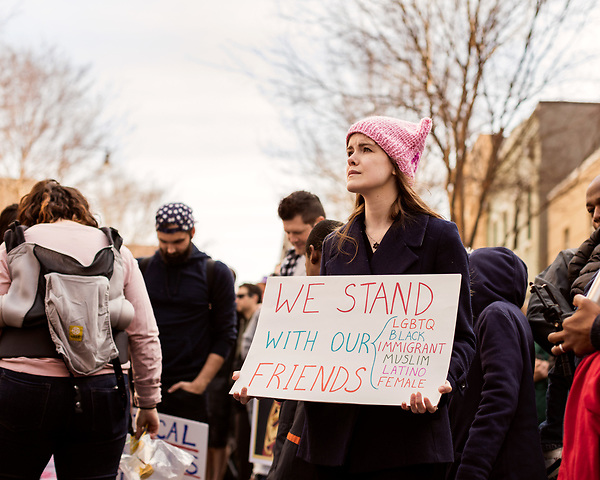 February 11, 2017. Raleigh, North Carolina.<br /> <br /> Angela Friedman of Durham NC listens to the speakers at the end of the HKONJ march. <br /> <br /> Thousands gathered in downtown Raleigh for the annual HKONJ People's Assembly, a civil rights march tied to the Moral Monday movement. Supporters from around the state gathered to march and speak out against nationwide attacks on civil rights and the Trump administration.<br /> <br /> Jeremy M. Lange for The New York Times