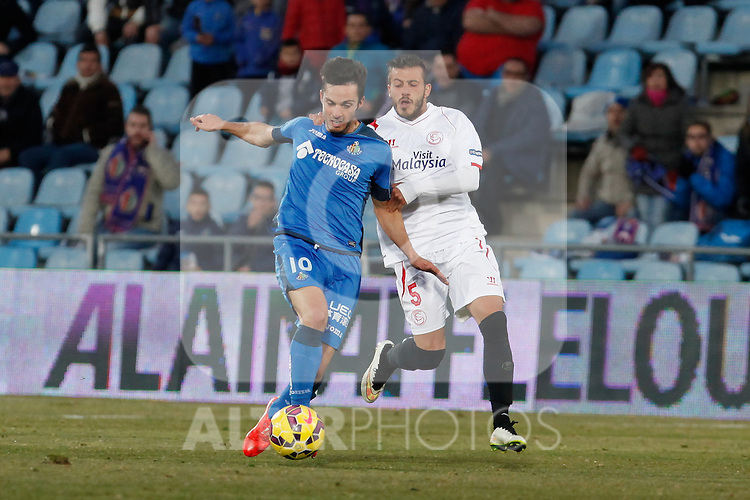 Getafe´s Sarabia (L) and Sevilla´s Diogo during 2014-15 La Liga match at Alfonso Perez Coliseum stadium in Getafe, Spain. February 08, 2015. (ALTERPHOTOS/Victor Blanco)