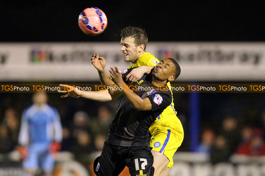 Danny Glozier of Concord Rangers  and Reggie Lambe of Mansfield Town - Concord Rangers vs Mansfield Town - FA Challenge Cup 1st Round Replay Football at the Aspect Arena, Thames Road, Canvey Island, Essex - 25/11/14 - MANDATORY CREDIT: Gavin Ellis/TGSPHOTO - Self billing applies where appropriate - contact@tgsphoto.co.uk - NO UNPAID USE