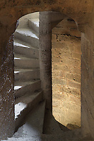 "Staircase inside the Keep, Queribus Castle or Chateau de Queribus, Cathar Castle, Cucugnan, Corbieres, Aude, France. This castle, built from 13th to 16th centuries, is considered the last Cathar stronghold. It sits on a high peak at 728m. It is one of the ""Five Sons of Carcassonne"" or ""Cinq Fils de Carcassonne"". It is a listed monument historique and has been fully restored, restoration work being completed in 2002. Picture by Manuel Cohen"