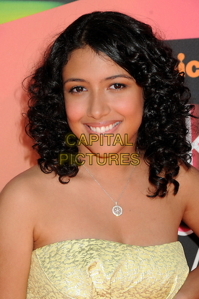 ASHLEY ARGOTA.The 23rd Annual Nickelodeon Kids' Choice Awards 2010 held at Pauley Pavilion in Westwood, California, USA..March 27th 2010 .arrivals headshot portrait yellow strapless silver necklace smiling .CAP/ADM/BP.©Byron Purvis/AdMedia/Capital Pictures.