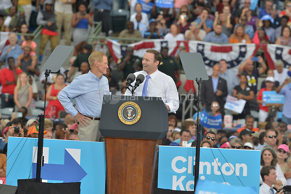 KISSIMMEE, FL - NOVEMBER 06: Sen. Bill Nelson (D-FL) and Democratic Representative from Florida Patrick Murphy (R)speak before President Barack Obama Campaign for Hillary Clinton to a crowd of 11,000 supporters join by Award-Winning Artist Stevie Wonder at Osceola County Stadium on Sunday, November 6, 2016 in Kissimmee, Florida. President Obama continued to stomp for Hillary with two day left to the election.  Credit: MPI10 / MediaPunch